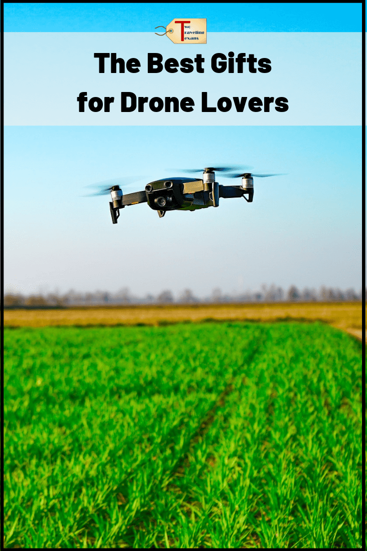 drone flying over a field with text overlay