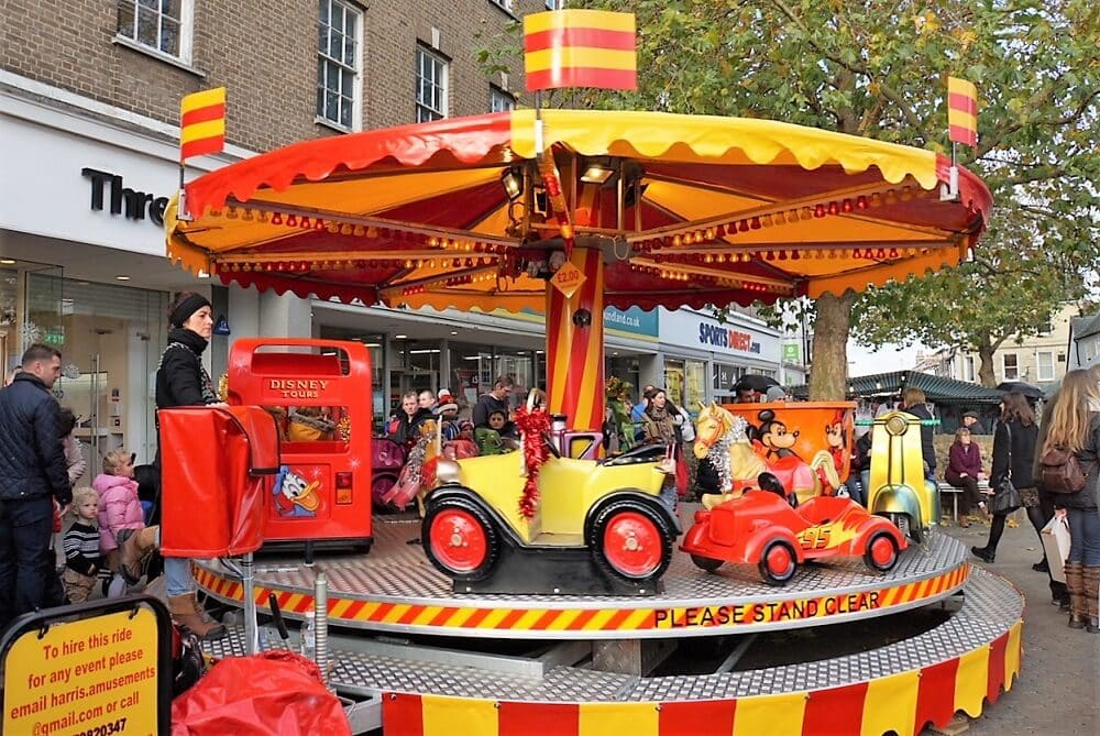 Carousel for younger kids at the Bury St. Edmunds Christmas Market - Two Traveling Texans