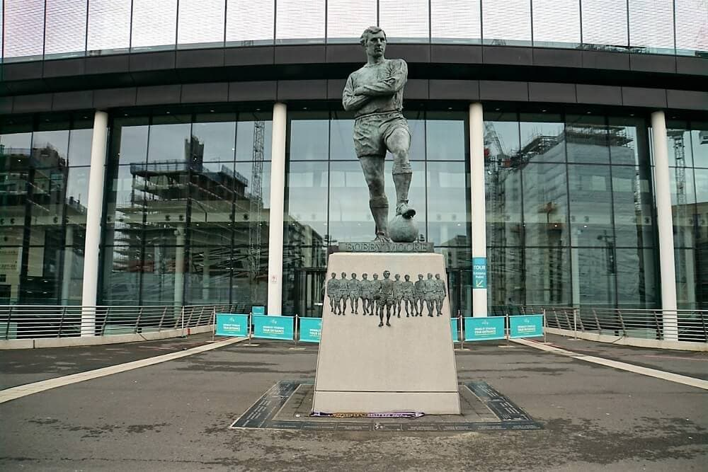 The Bobby Moore statue outside Wembley Stadium - Two Traveling Texans