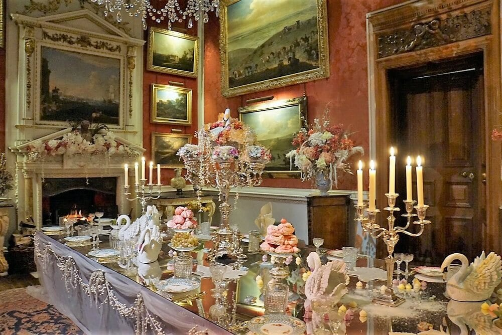 One of the dining rooms inside the House decorated with swans a swimming. - Two Traveling Texans