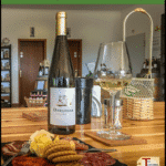 """wine with plate of cheese, crackers, and meat with text overlay """"Wine Tasting in the Algarve, Portugal, with Algarving Tours"""""""