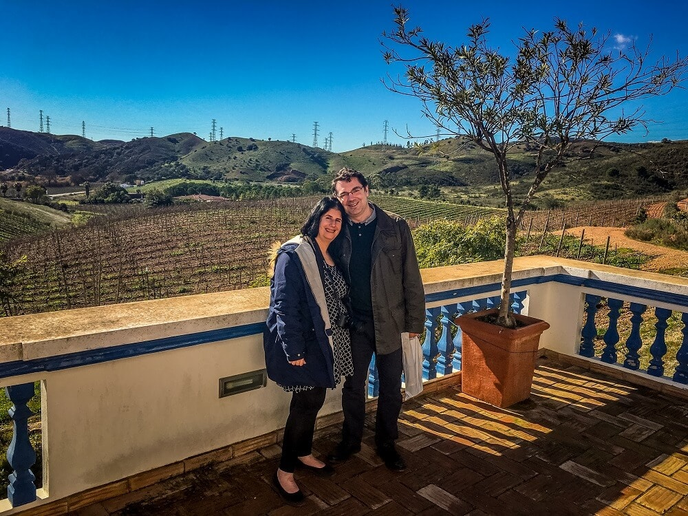 Anisa and Russell by a vineyard in the Algarve in Portugal