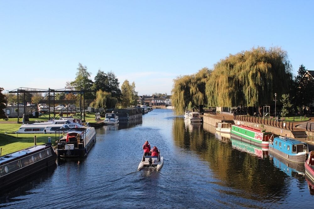 Riverside in Ely, boats, weeping willows