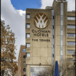 """Guoman tower hotel in London with text overlay """"Tower Hotel Review - London, England"""""""