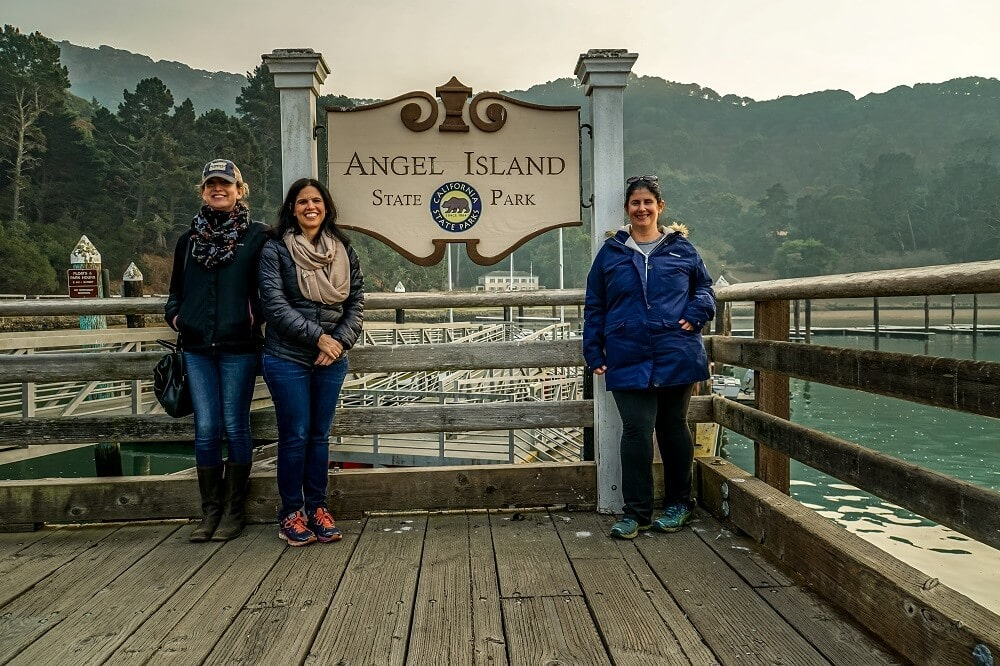 Anisa with friends by Angel Island Sign