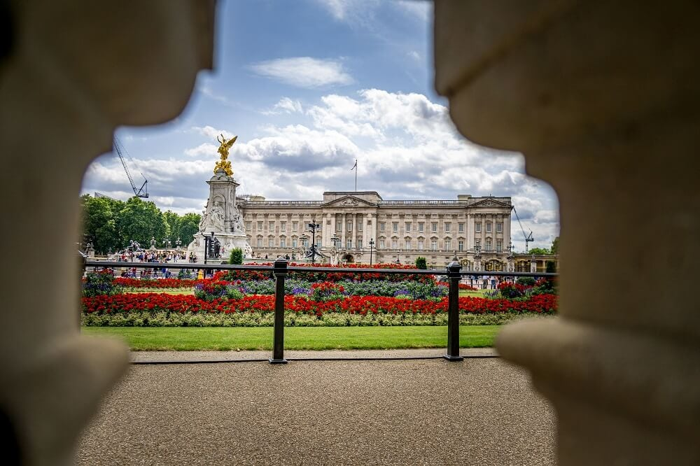 view of Buckingham palace through the wall by Constitution Hill. wall