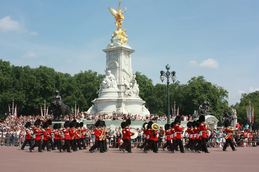 band marching by the Victoria memorial for the changing of the guard at Buckingham Palace.