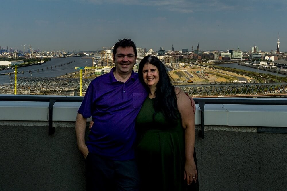 Russell and Anisa on the roof of the Holiday Inn Hamburg with views of the city of Hamburg in the background.