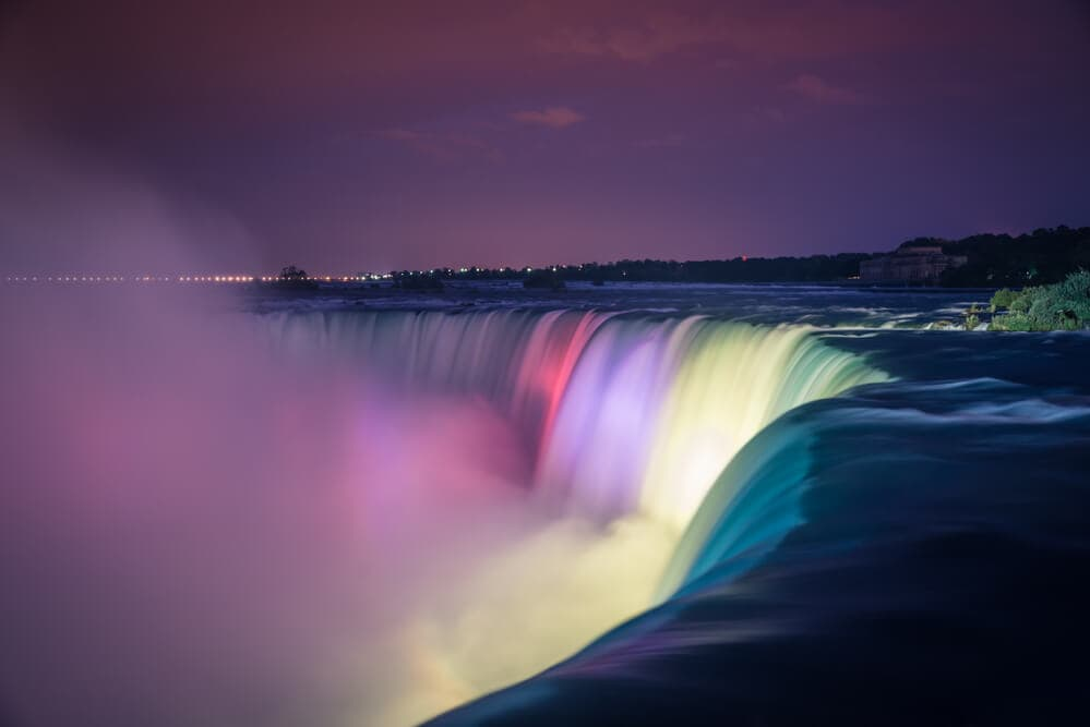 Niagara Falls illuminated in many colorsat Night
