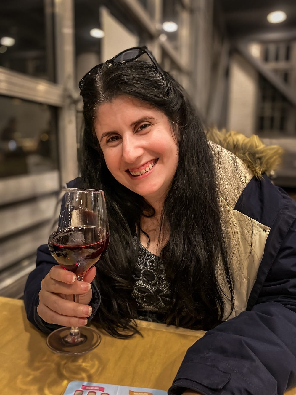 Anisa smiling and enjoying the wine at the Brooklyn West Winery