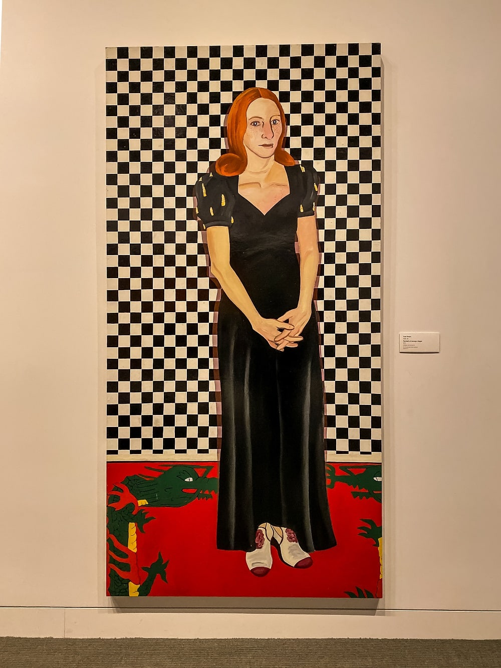 Portrait of Carolyn Singer with a checkered background