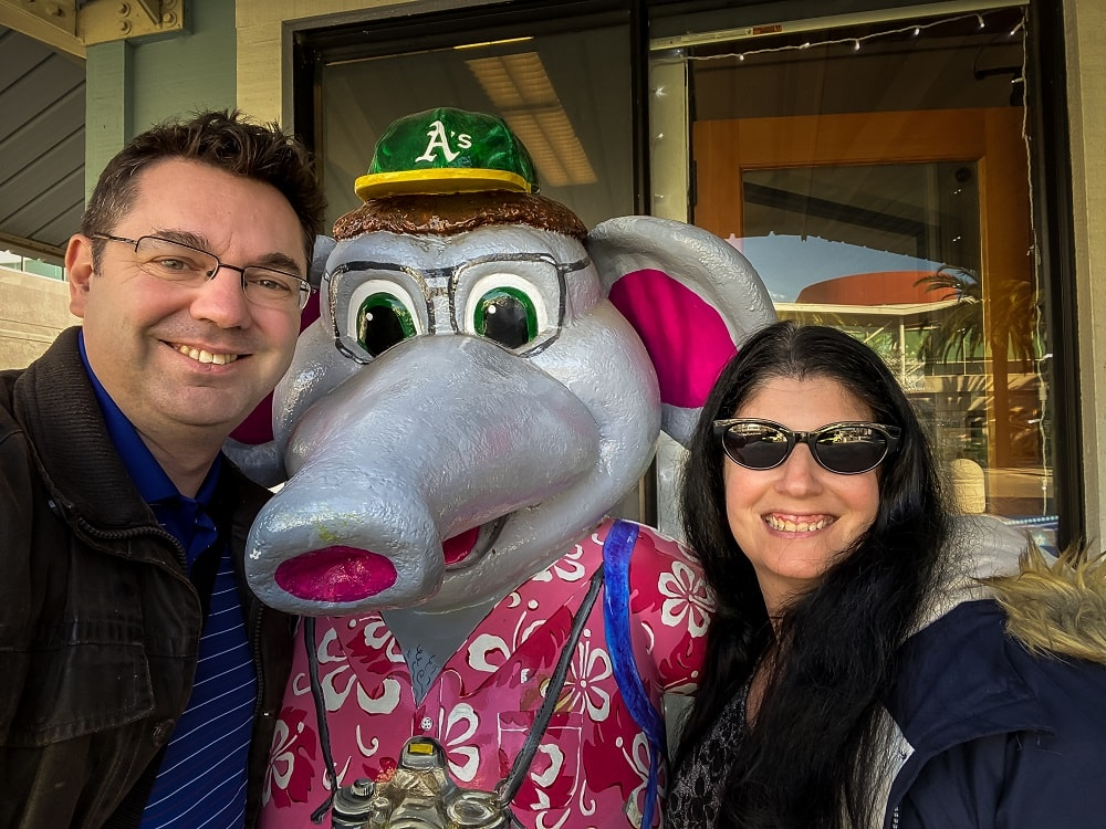 Russell and Anisa with the Oakland A's mascot (an elephant)