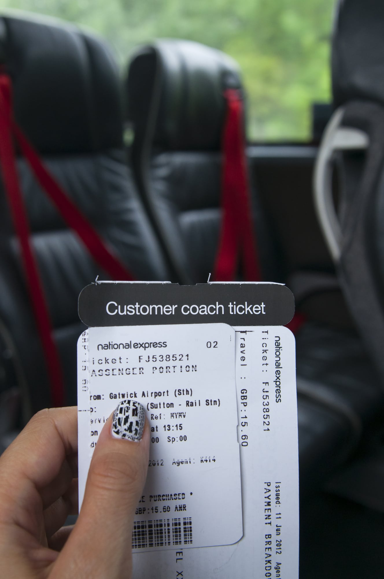 closeup of Gatwick National Express Bus ticket, in the background you can see the luxury seats in the bus