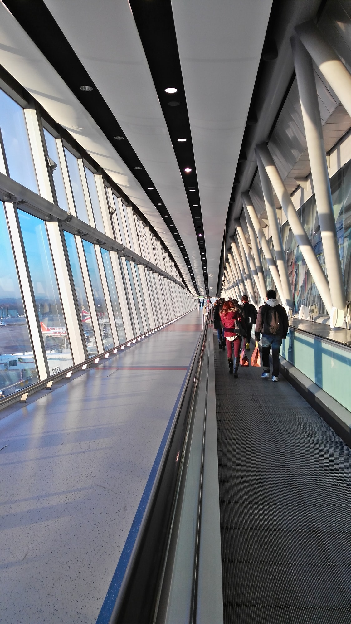walkway inside Gatwick Airport, first part of the journey from Gatwick to London