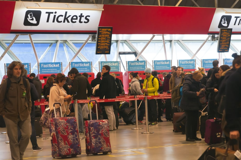 line of people to get tickets at Gatwick Train station