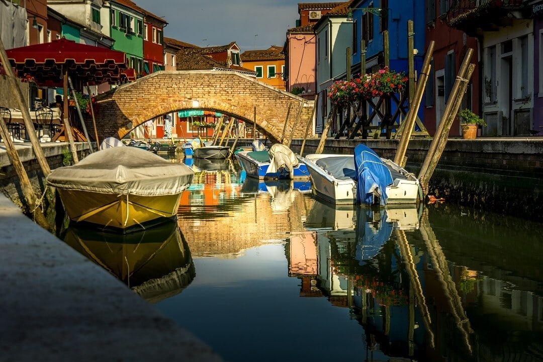 bridge and colorful canal in Burano in Italy