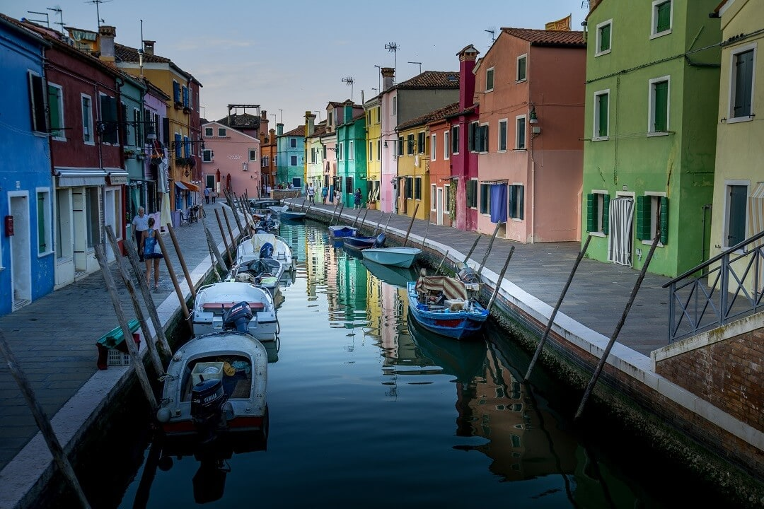 colorful canal in Burano with boats
