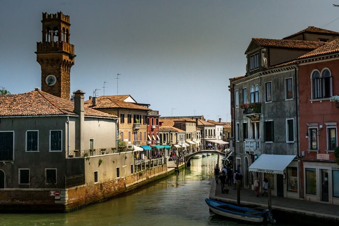 tower and canal in Murano Italy