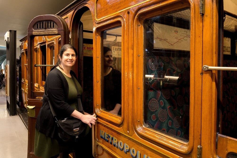 Anisa boarding an old train at the London Transport Museum