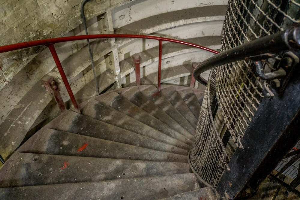 spiral stairs leading down to clapham south shelter