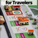 "custom monopoly game board with text overlay ""the best board games for travelers"""