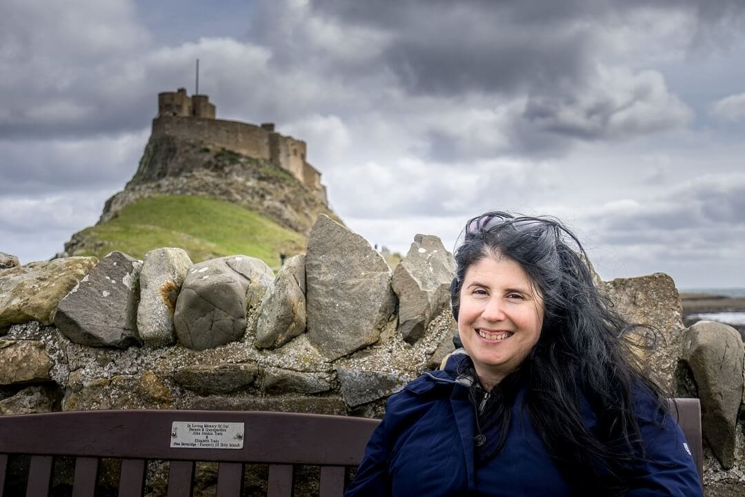 Anisa with Holy Island Castle in the background