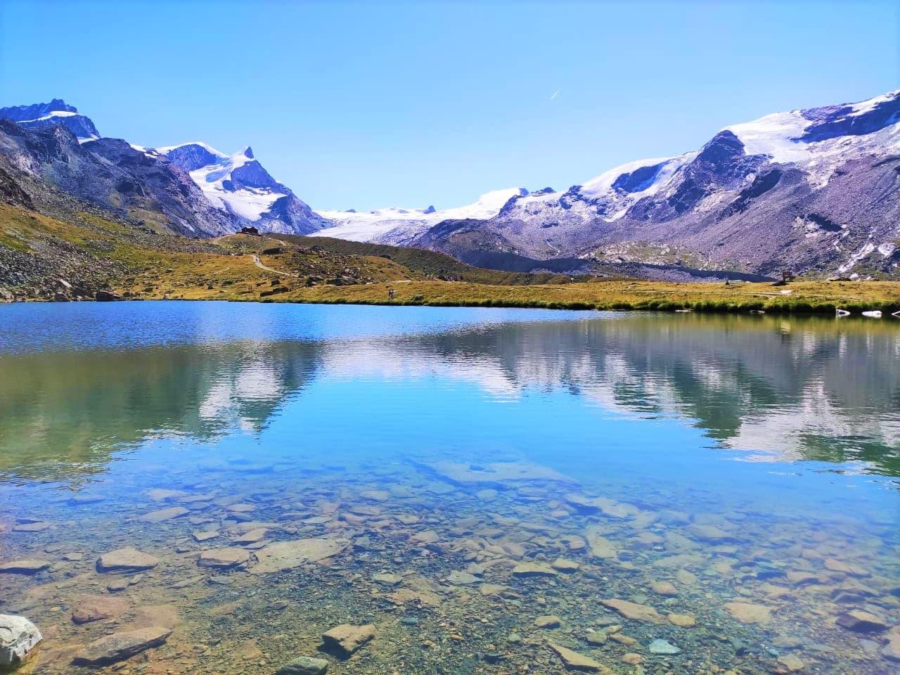 Stellisee Lake as see on the Five Lakes Hike in Zermatt Switzerland
