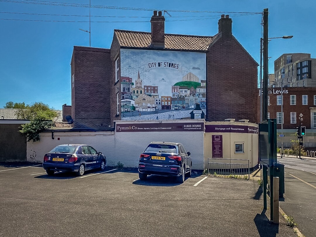 norwich street art - a mural of the city center