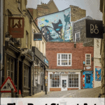 "norwich city street with text overlay ""The Best Street Art in Norwich England"""