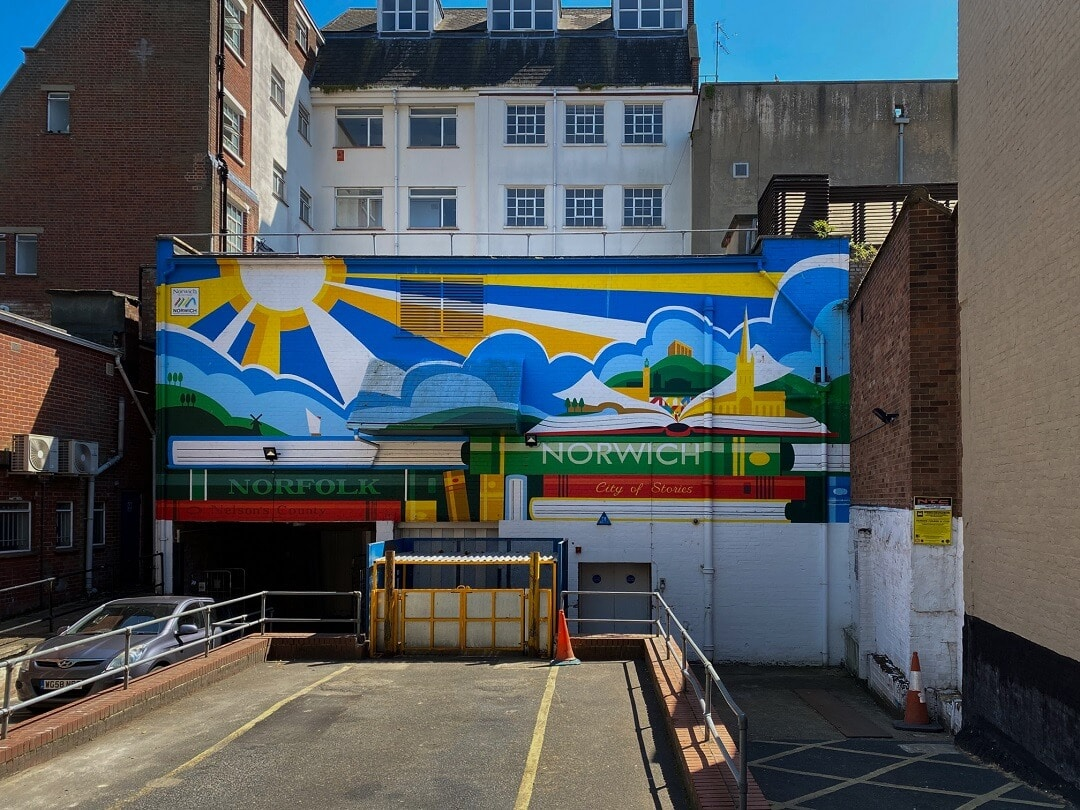 norwich mural with books and rays of sunshine