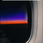 """sunrise from plane window with text overlay """"how to survive red eye flights"""""""