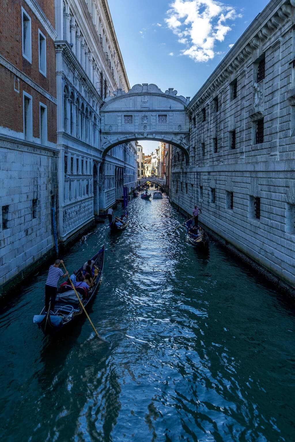 gondolas about to go under the bridge of sighs in Venice