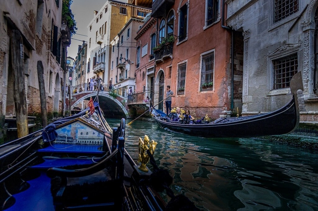 two gondolas on a small canal in Venice