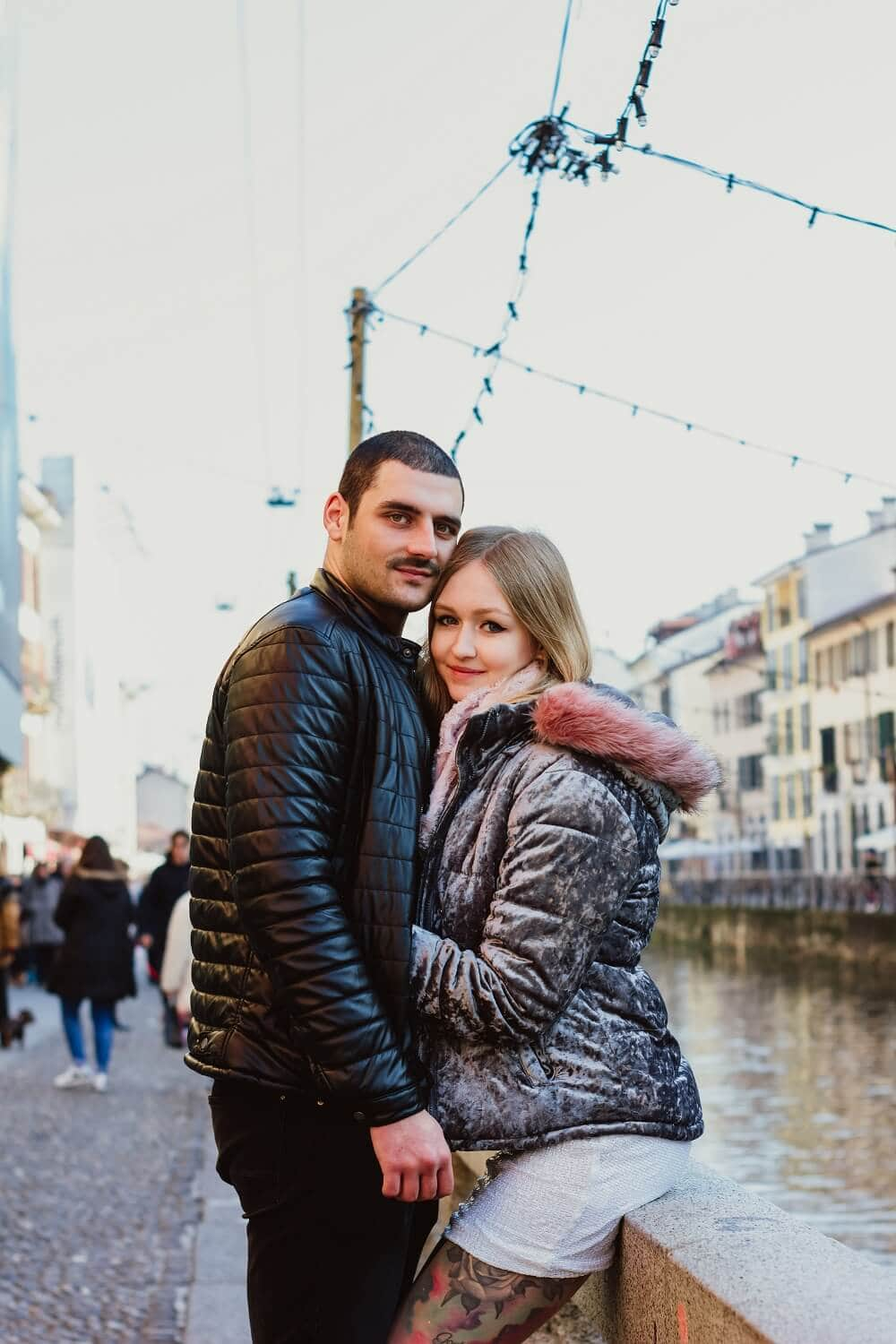 couple by the canal in Naviglio in Milan