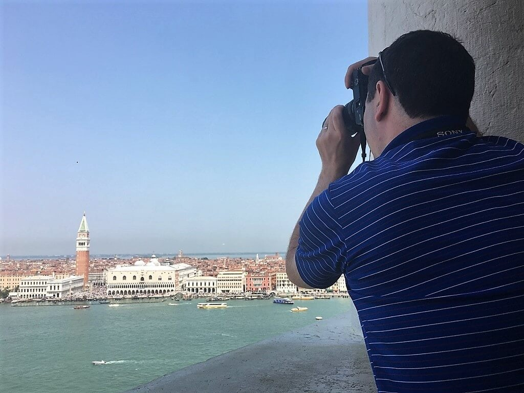 Russell taking a photograph of St. Mark's square from the San Giorgio Maggiore tower