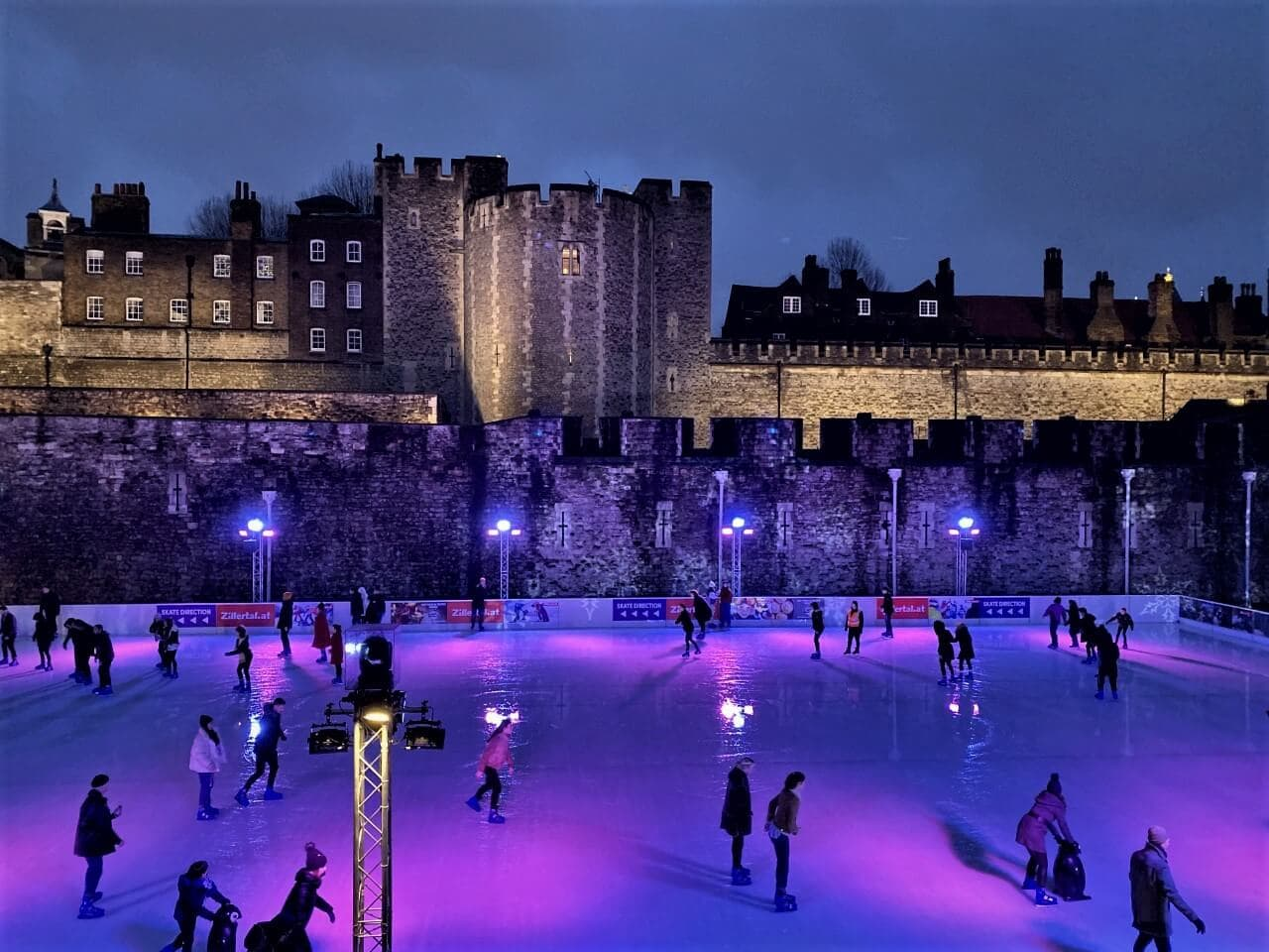 ice skating rink in front of the tower of london in the winter