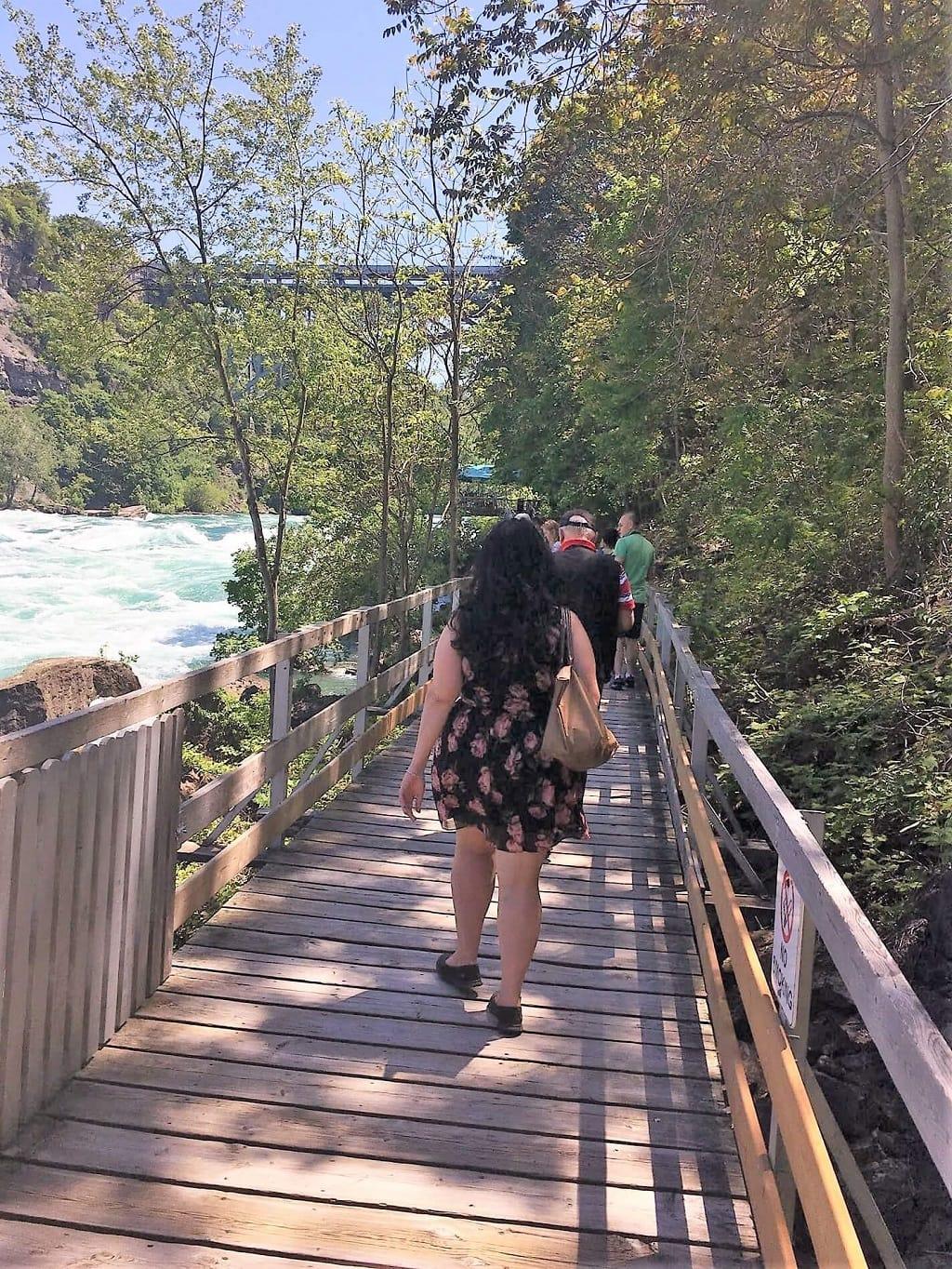 Anisa enjoying the White Water walk on a wooden bridge along the Niagara River.
