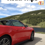 """red sports car on the road with text overlay """"30+ romantic road trips"""""""