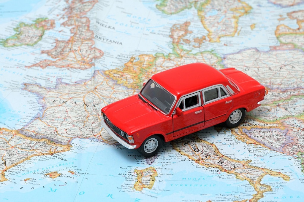 map for road trip and a red toy car