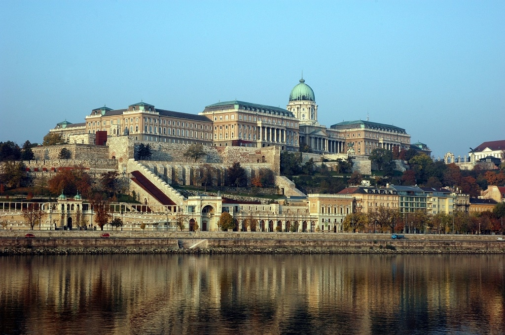 buda castle by the danube river in budapest