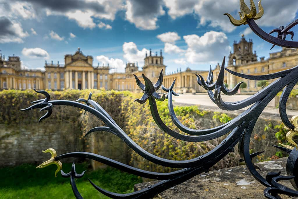 looking at blenheim palace through the edge of the gates
