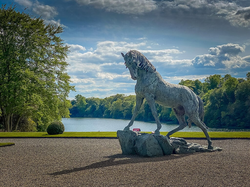 horse sculpture with Blenheim great lake in the distance