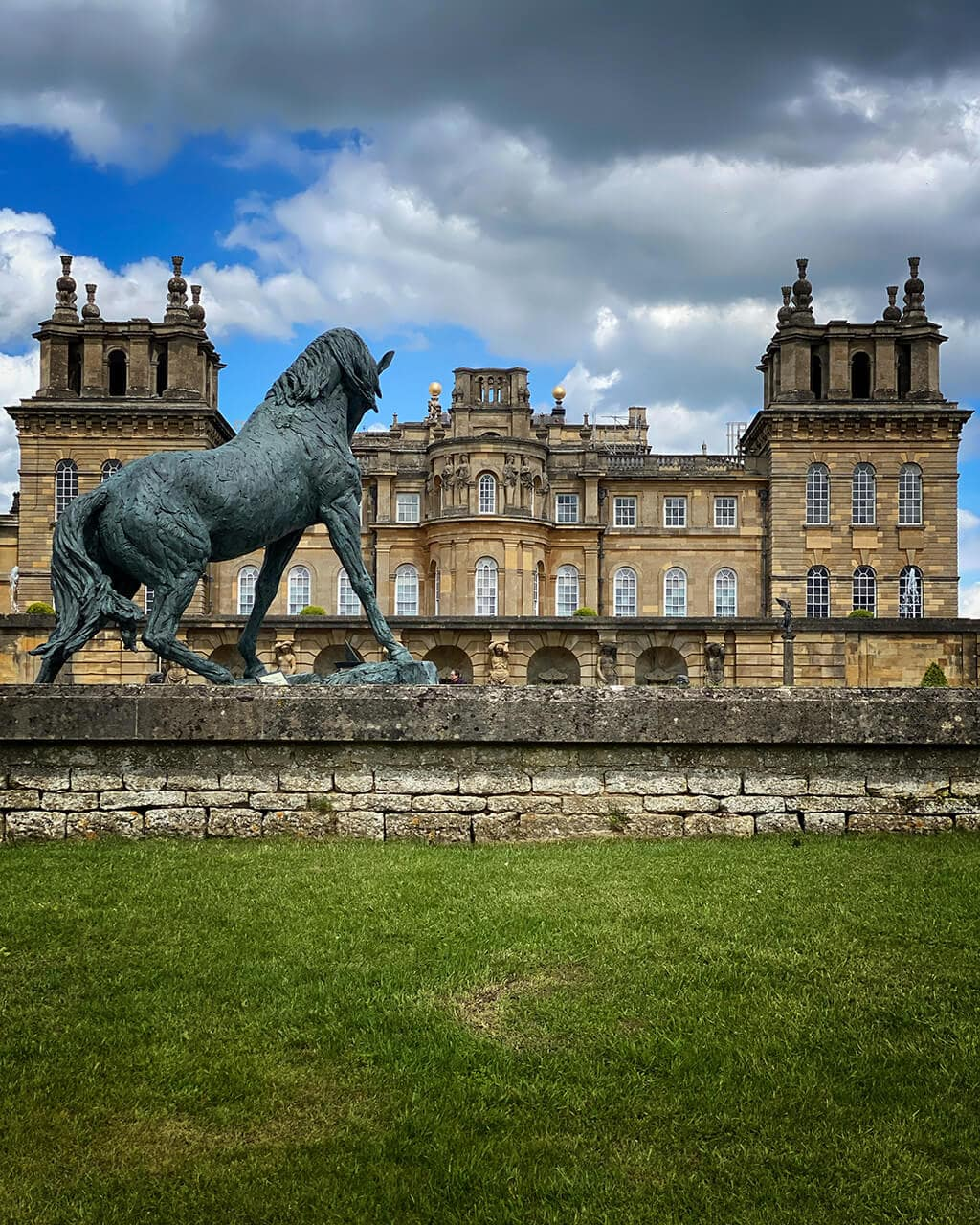 sculpture of horse in front of blenheim palace