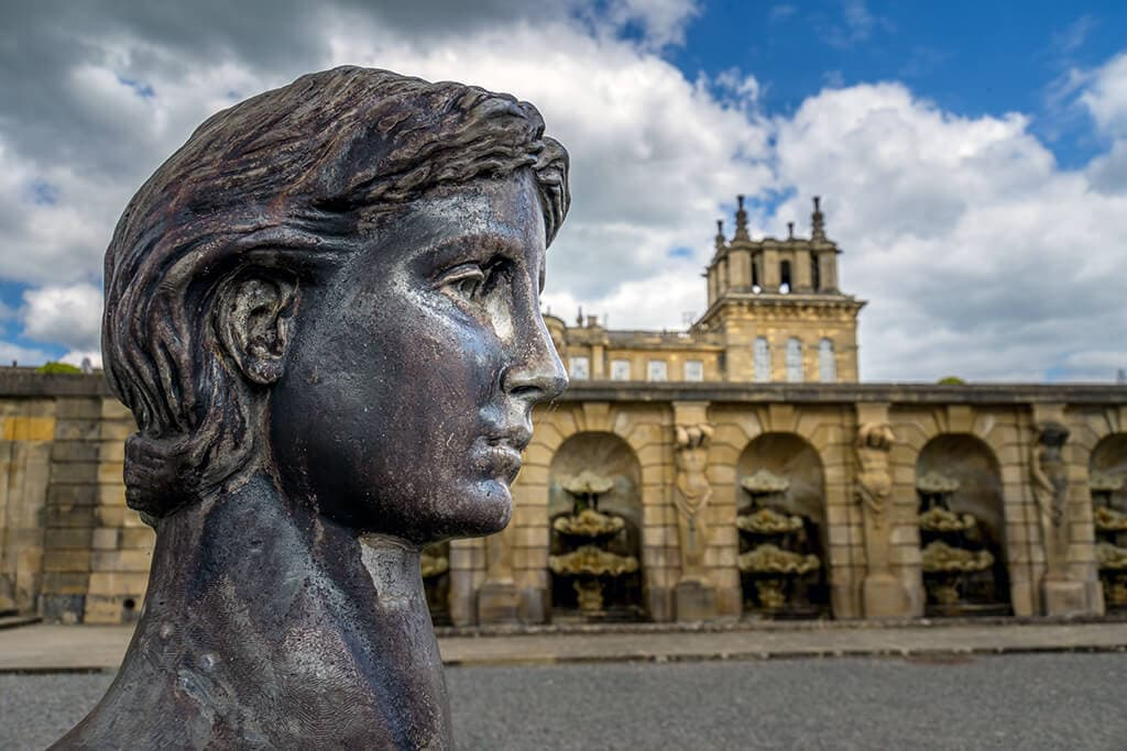 sphinx head in water terrace at blenheim palace