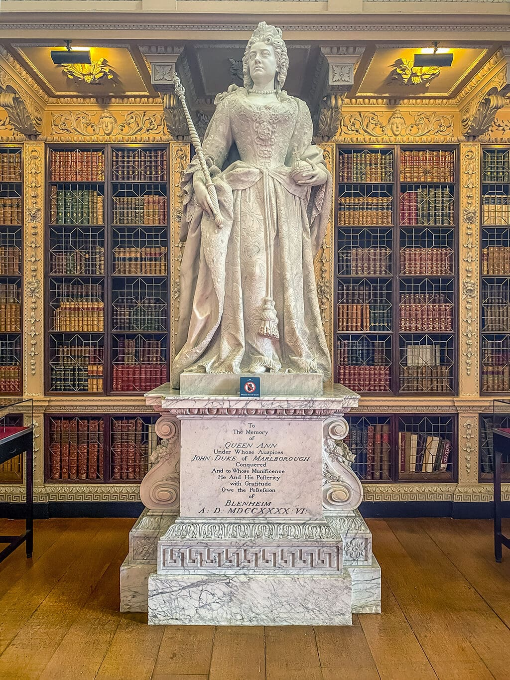 statue of queen anne in the library of blenheim palace