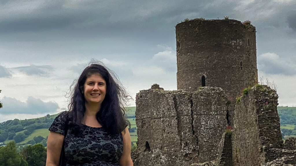 Anisa in front of tretower castle, one of the best things to do in the brecon beacons